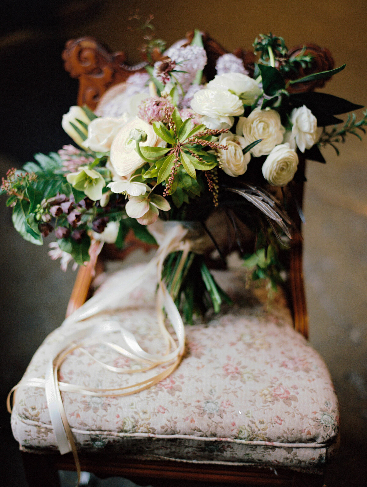 brides bouquet on a chair