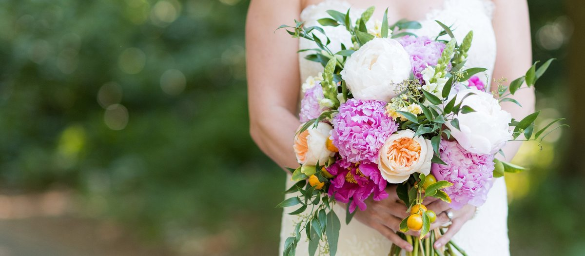 Bride holding beautiful pink peony bouquet photo