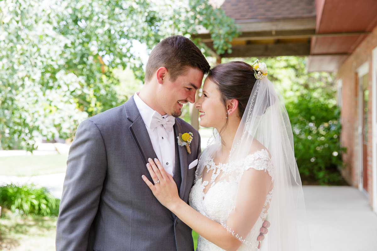 couples-candid-moment-Colorado-garden-wedding