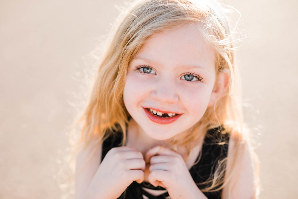 Kindergartener laughs as her photos is being taken