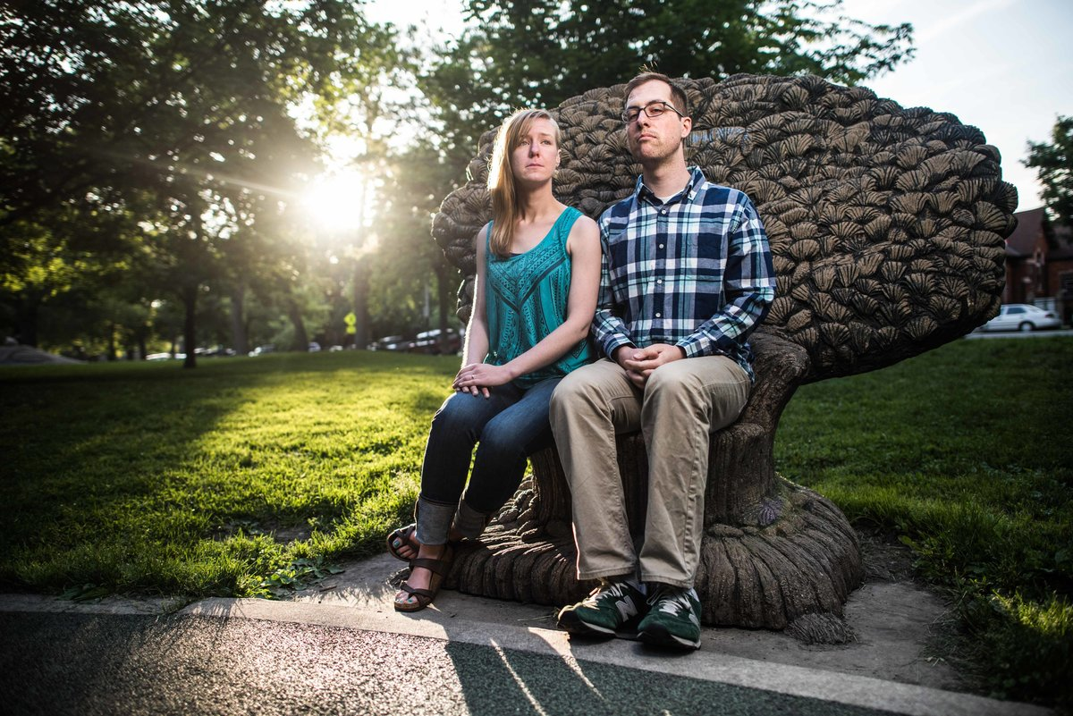 Couple sits on throne for engagement, sun low, Chicago.