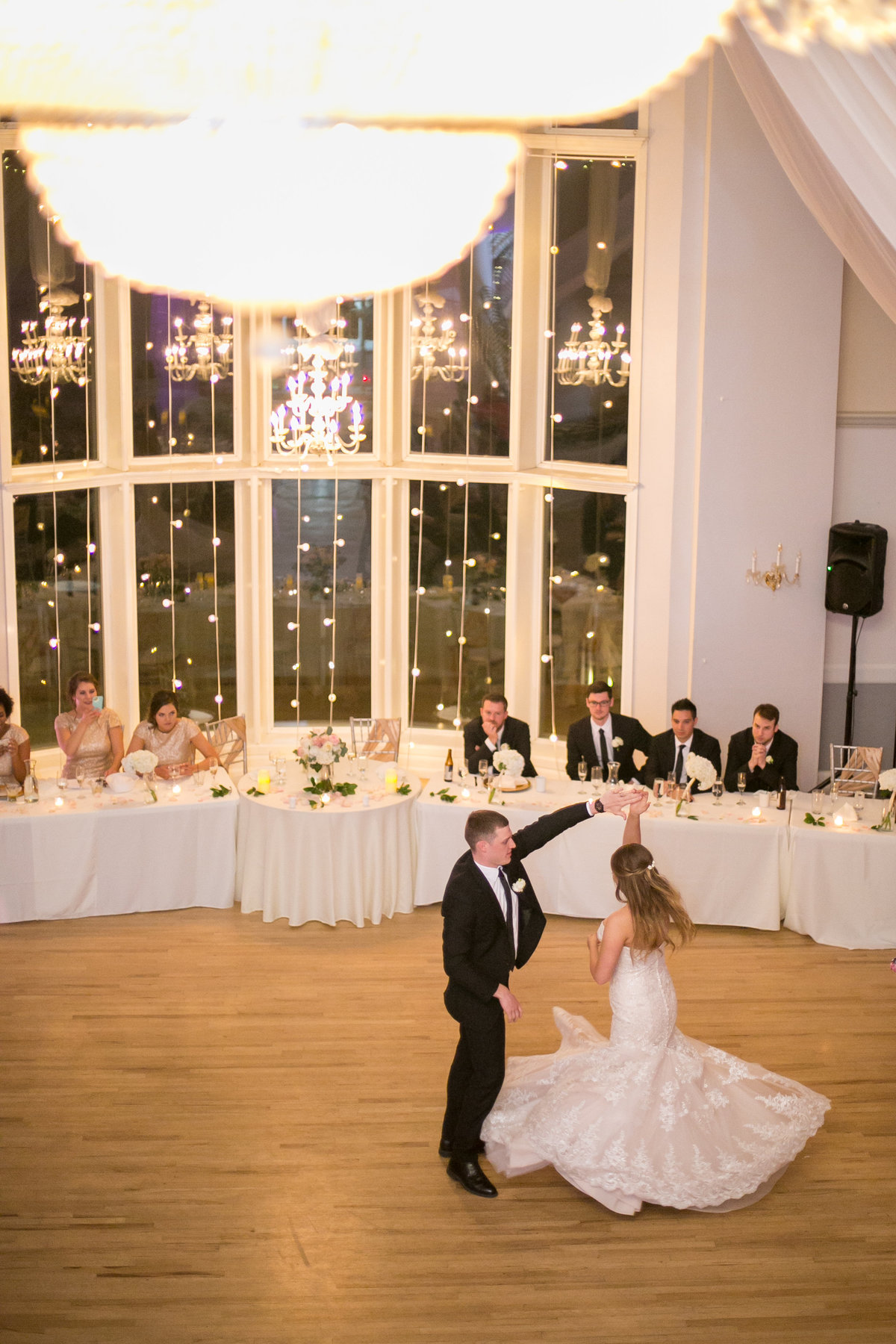 Groom spinning bride during first dance