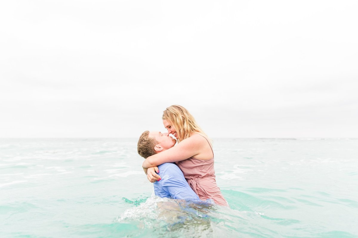 in water swimming pacific ocean engagement photography