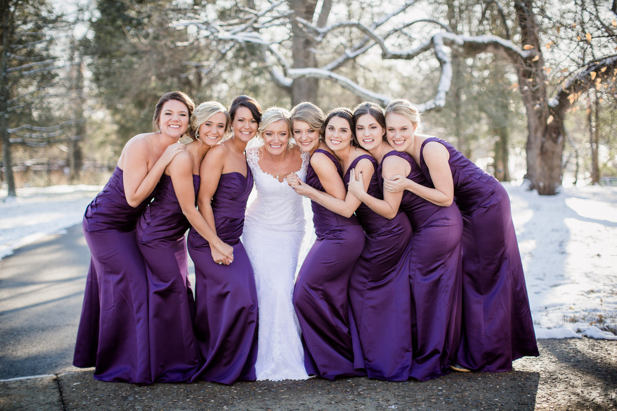 Bride and bridesmaids in purple dresses during snowy wedding day at Historic Westwood by Knoxville Wedding Photographer, Amanda May Photos.