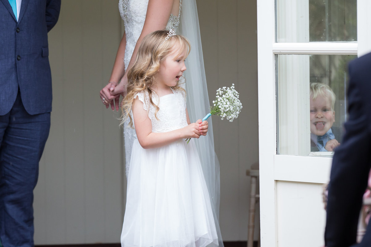 flowergirl at natural  wedding photography in devon