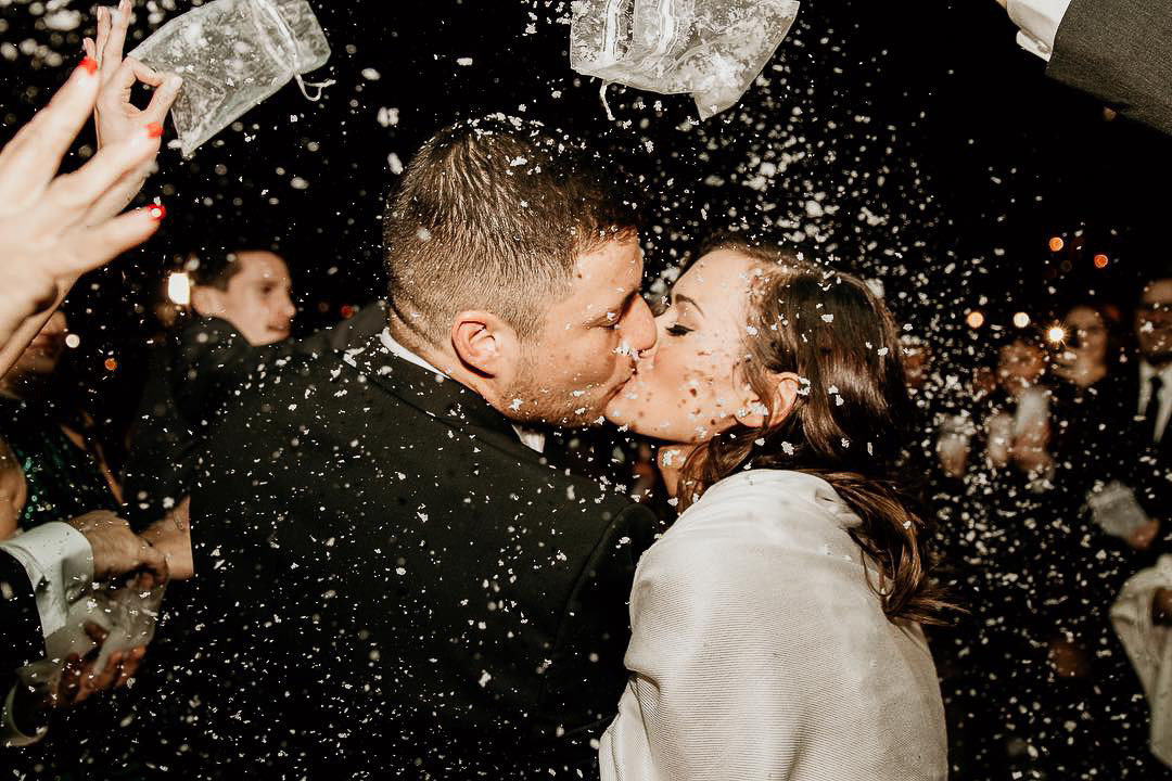 chicago-wedding-photographer-kiss-winter-send-off-snow-2
