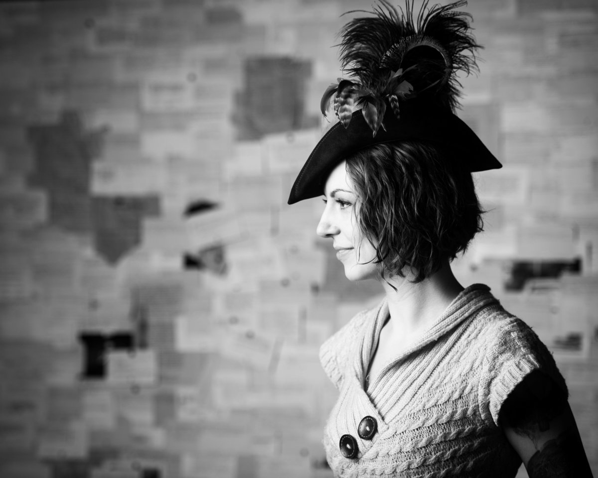 Chicago portrait, woman looking left, feather hat.