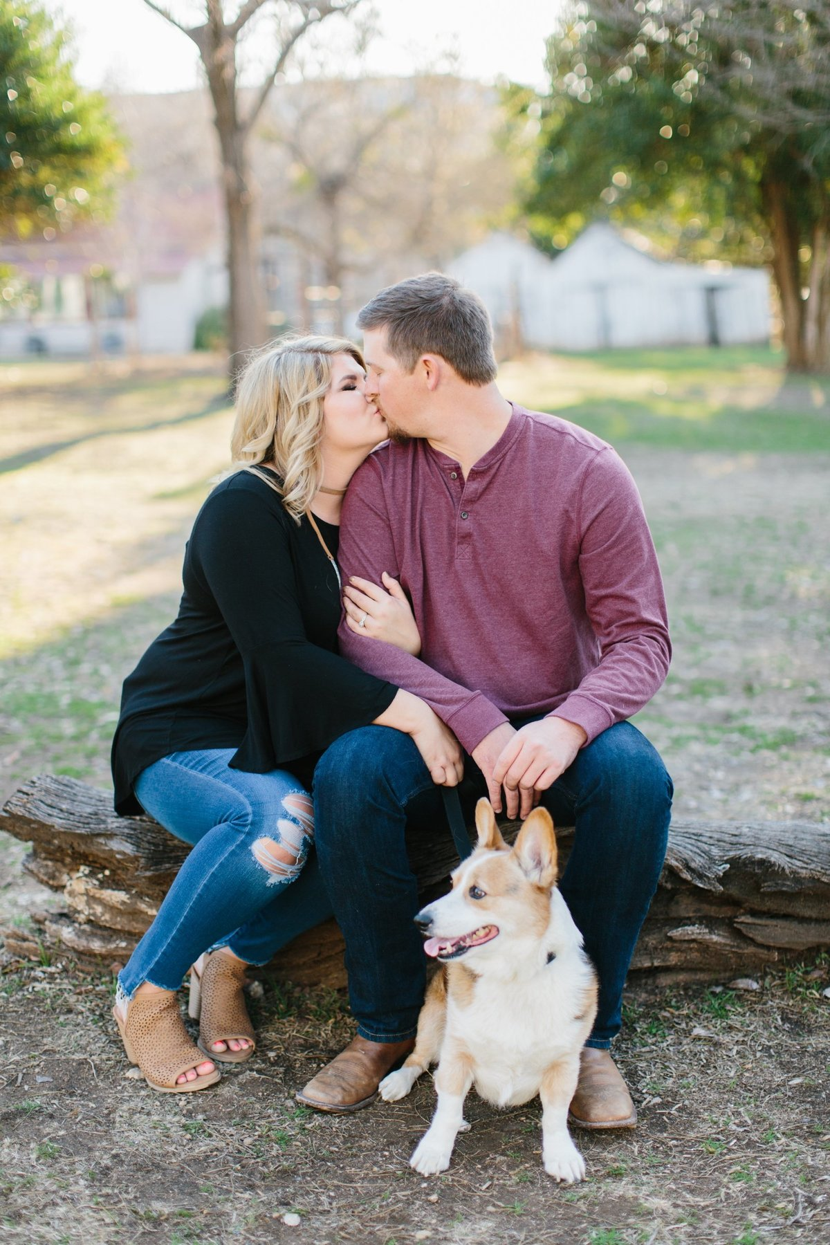 Film Engagement Session in Gruene, Texas. Bride wearing black top and distressed ripped jeans top, groom is wearing a burgundy long sleeve top and jeans. With their dog, a corgi!