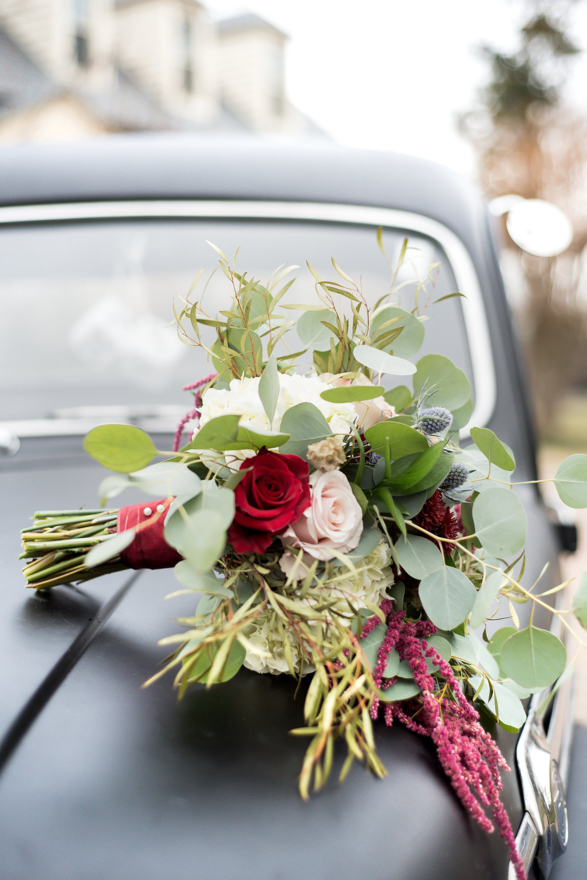 Vintage truck and wedding bouquet at The Manor House of Kings Charter.