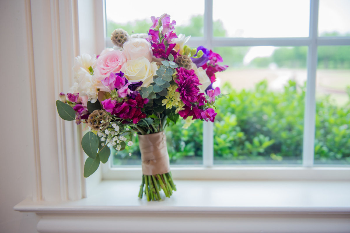 Purple wedding flowers at The Milestone by Brittany Barclay Photography