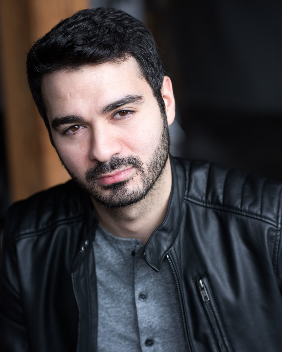Chicago headshot, male, facial hair and leather jacket.
