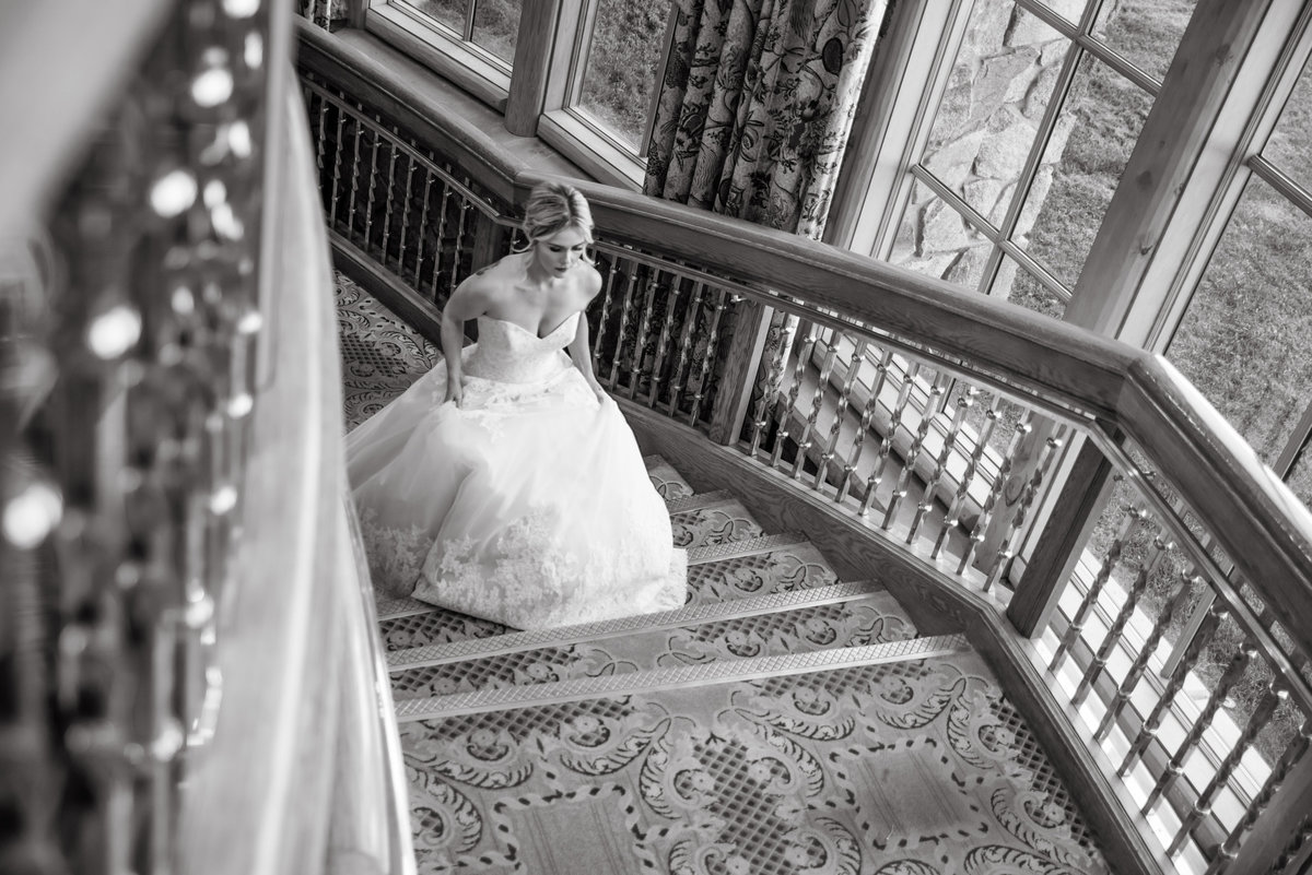 black and white photo of bride entering venue at Snow basin Ski resort