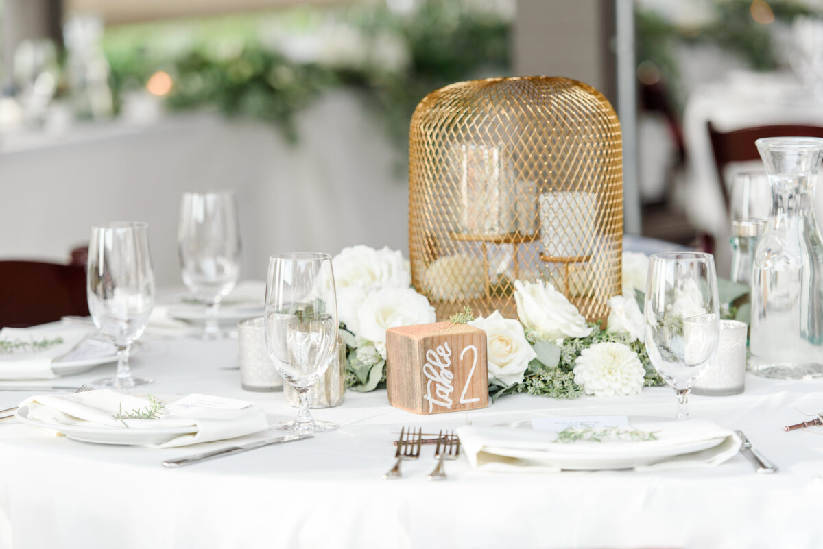 table decoration with candles and gold lantern