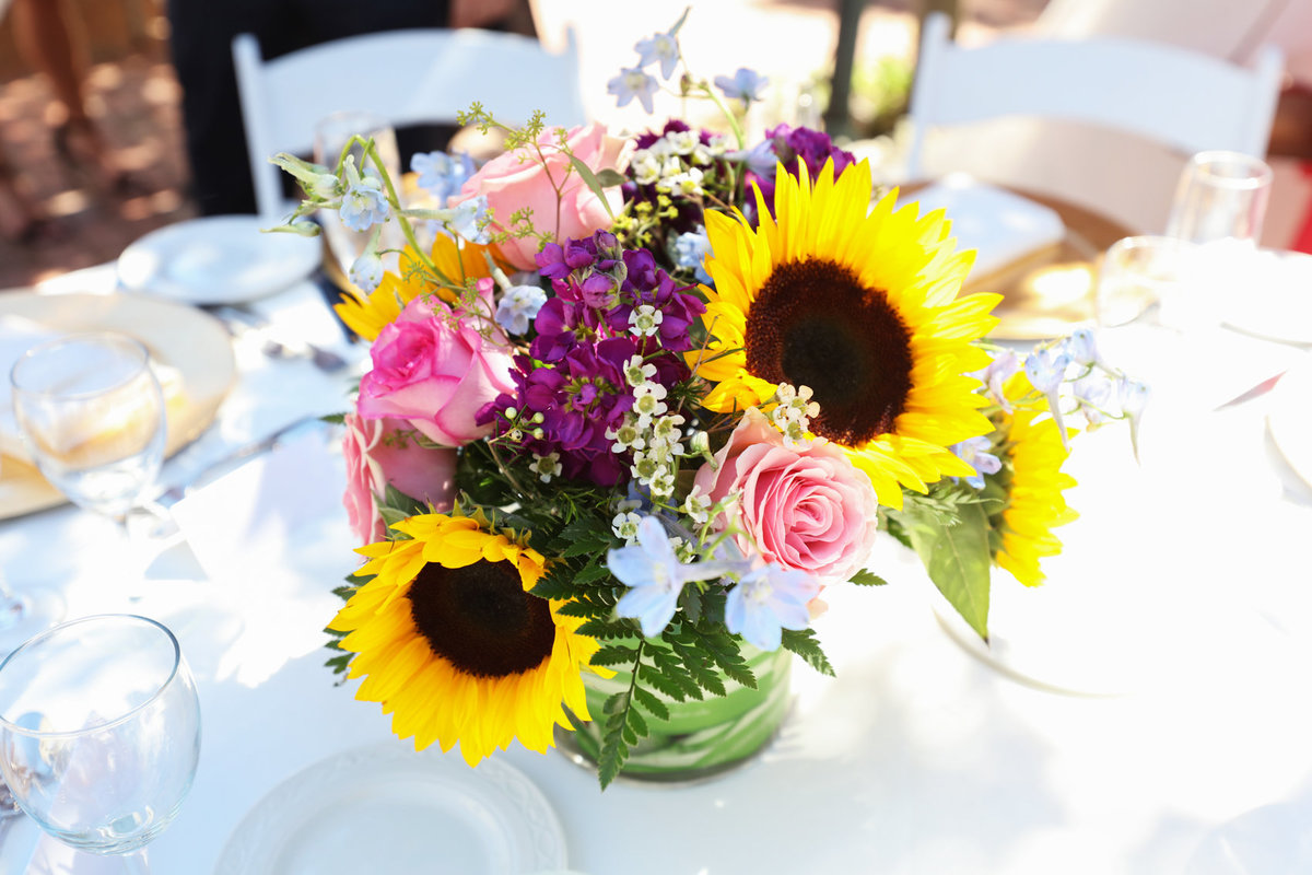Close-up portrait of bouquet sunflowers centerpiece for reception