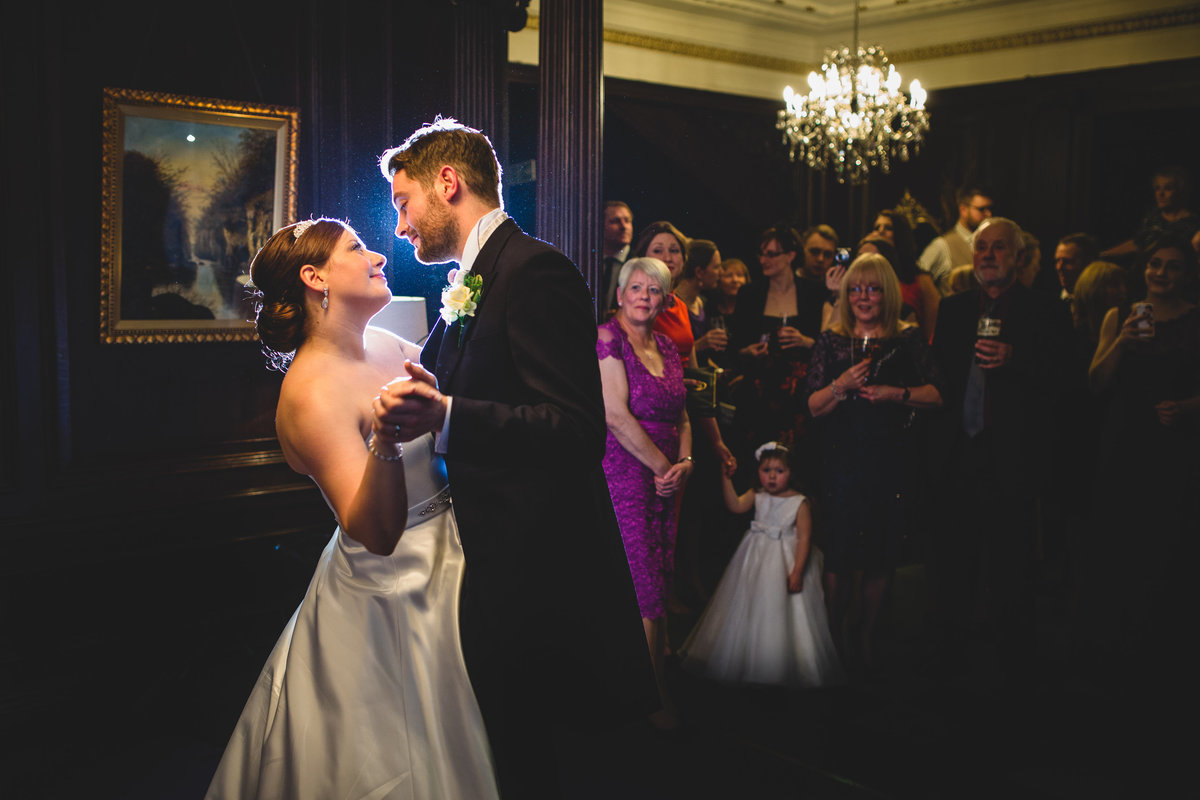 the bride and grooms first dance at eaves hall. backlit photo