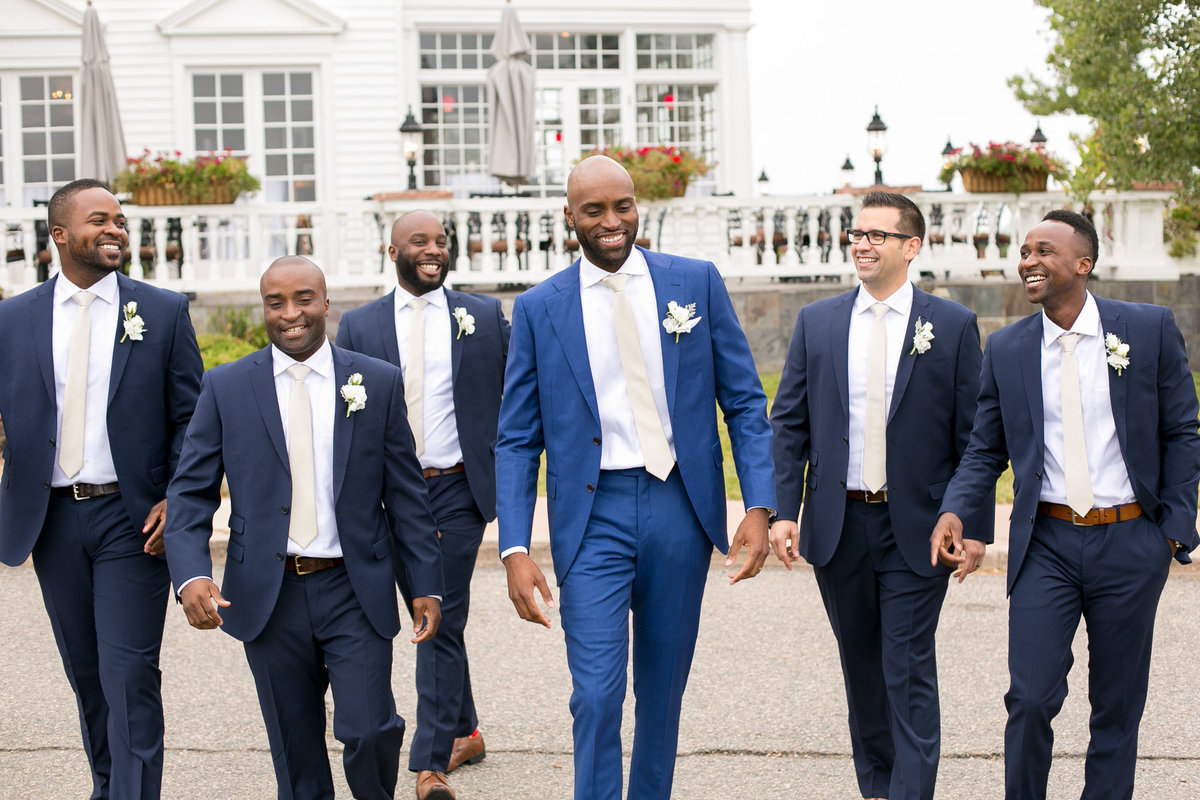 Groomsmen walking in blue suits