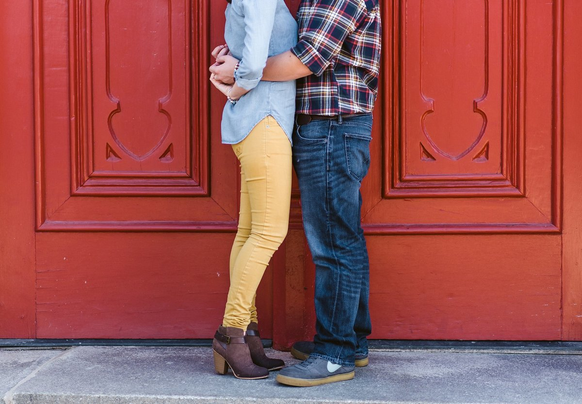 color engagement session with red doors in fredericksburg