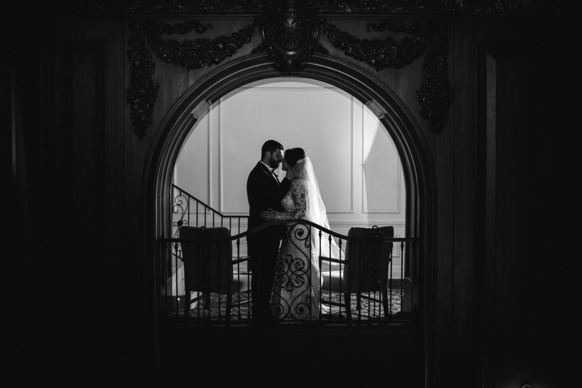 Bride and groom black and white in the arches at The Read House Wedding Venue by Knoxville Wedding Photographer, Amanda May Photos.