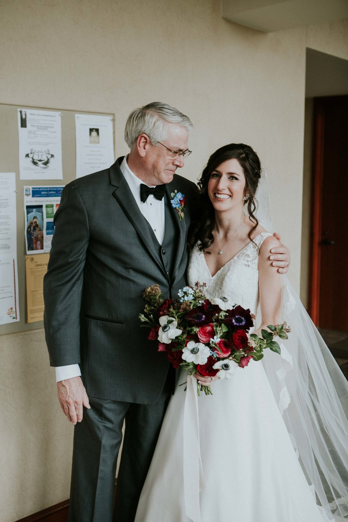 Father of the bride looks at his daughter proudly right before her columbus indiana wedding