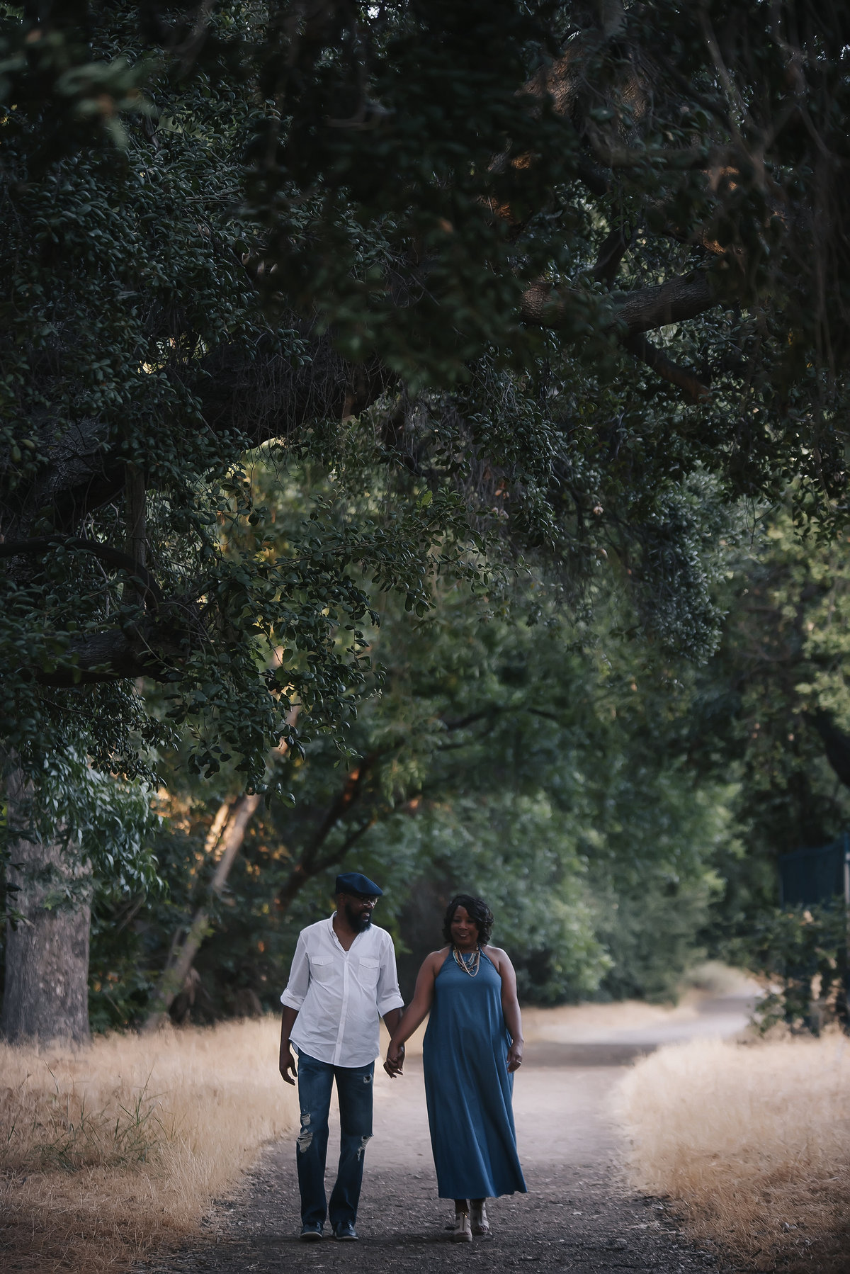 couple-engagement-walking-trees