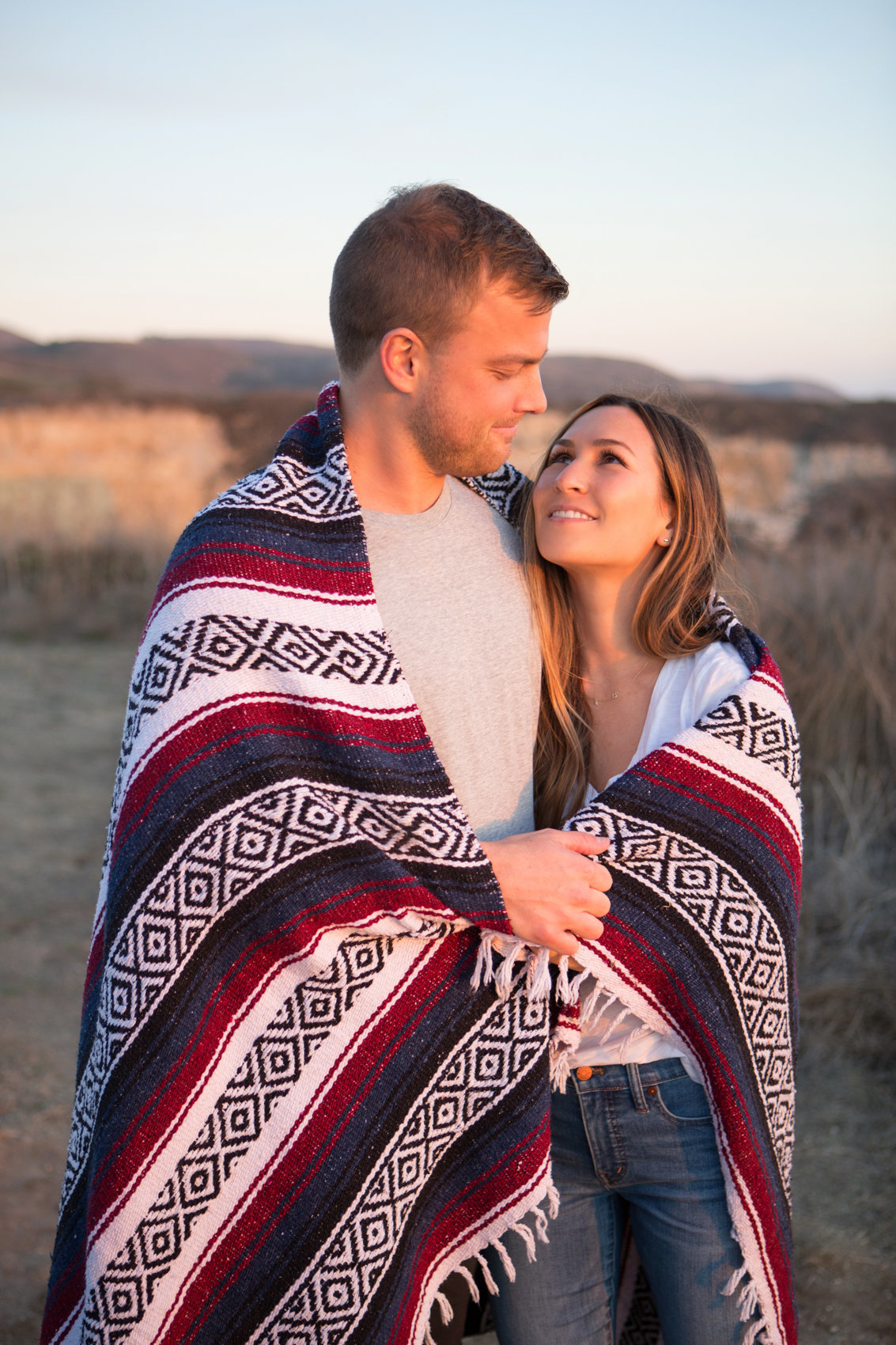 Bride and groom in blanket, natural light portrait in evening, northern california photoshoot with deneffe studios