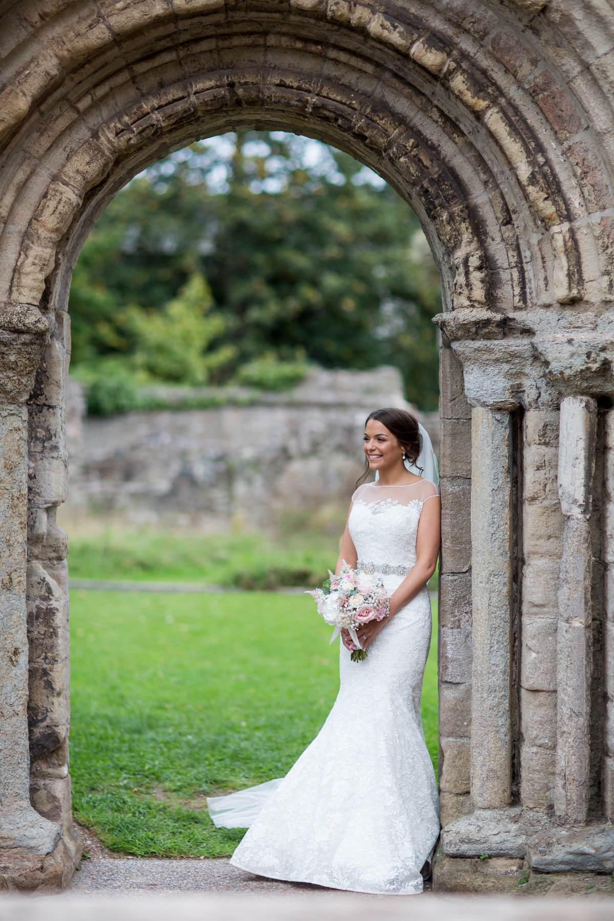 bride at torre abbey ruins photography by evolve