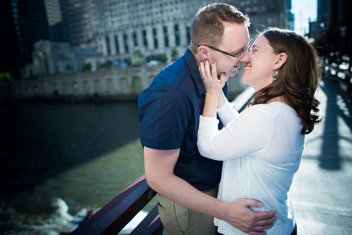 Couple kisses by Chicago River.
