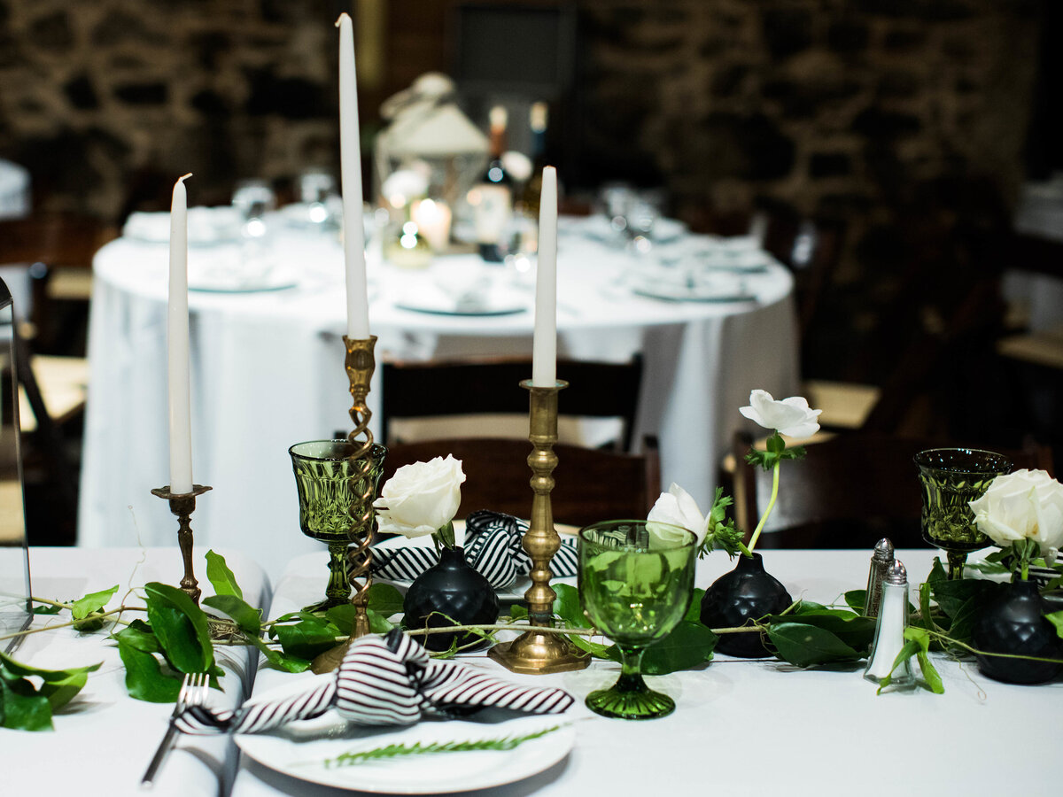 long head table decorated with greenery