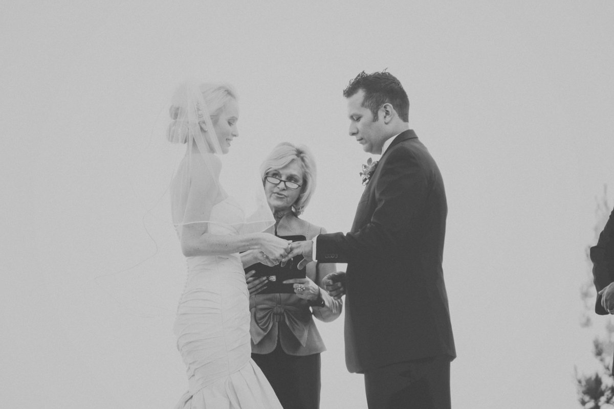 black and white photo of bride and groom exchanging rings at the wedding ceremony | Susie Moreno Photography