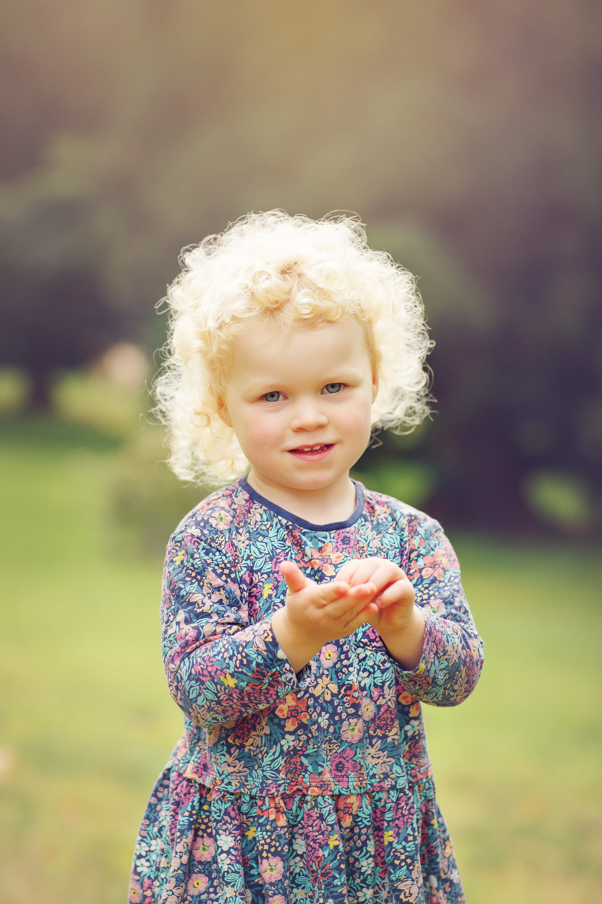 little girl with blonde curly hair