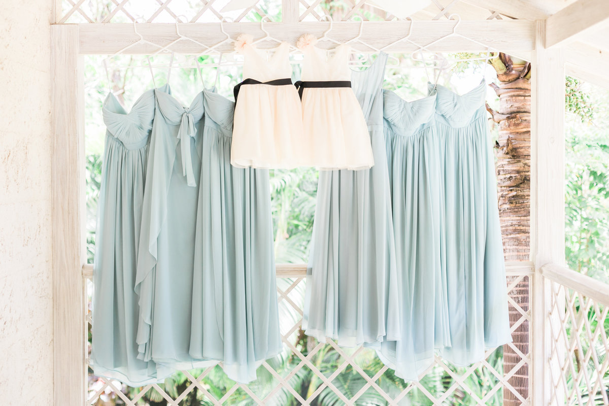 Bridesmaid dresses by Jenny Yoo can be tied in 15 different ways.  White flower girl dresses by Crew Cuts by J. Crew