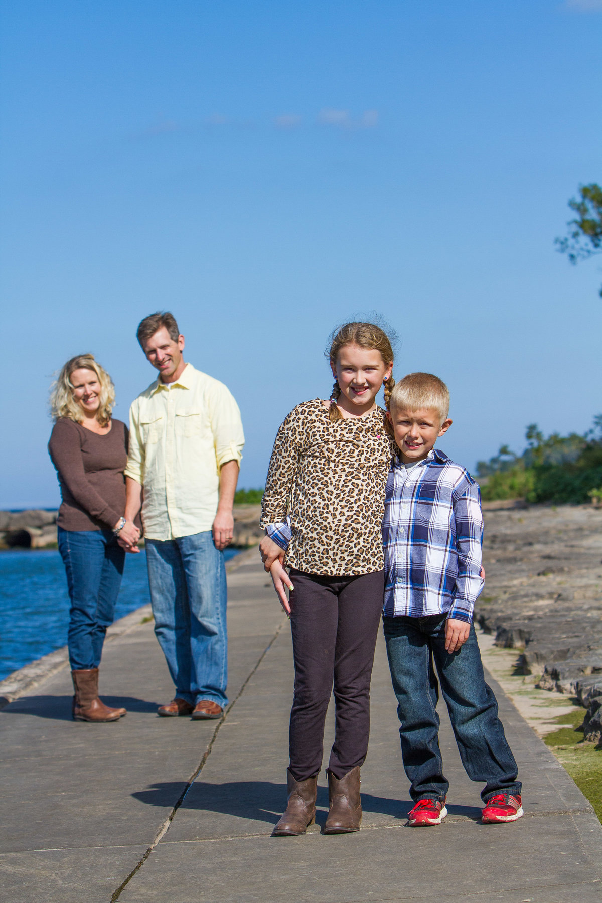 Family portrait on boardwalk by lake ontario