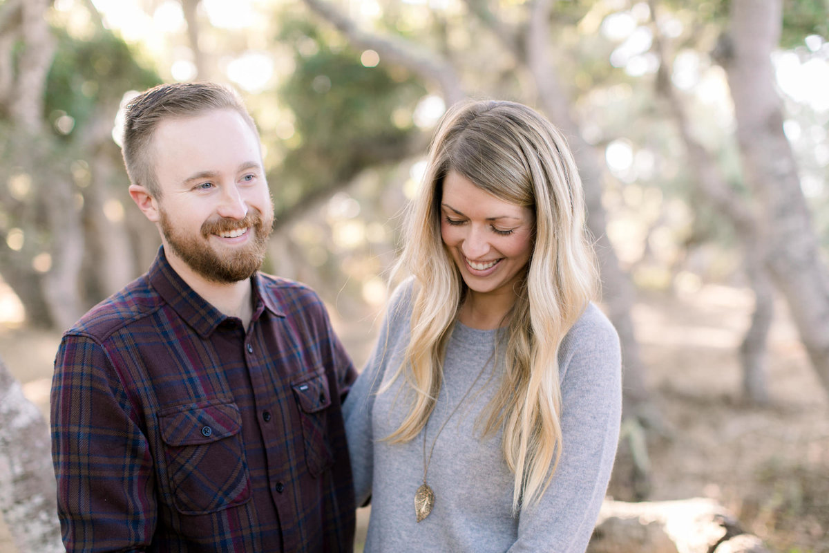 couple laughing at their engagement session in Los Osos, Ca