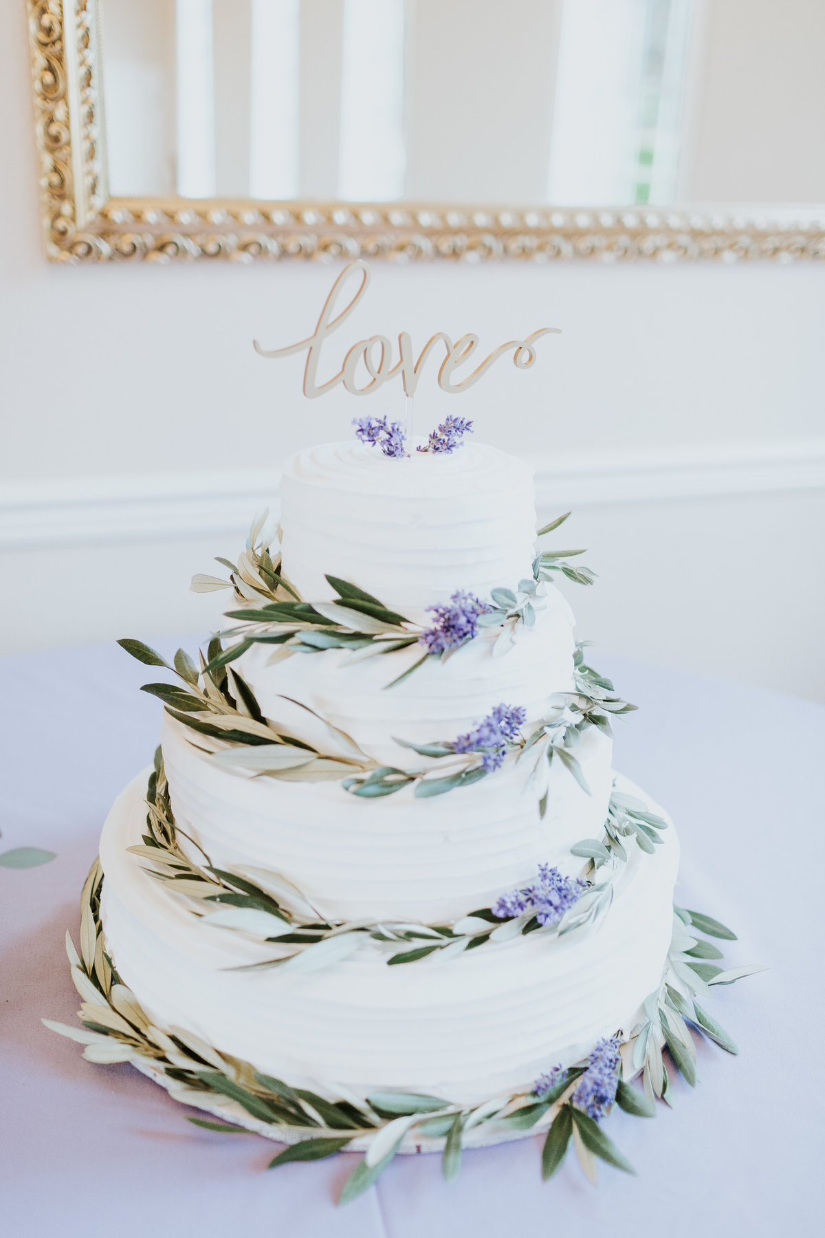 Lavender and olive branches on simple white wedding cake Bastyr Univeristy Chapel Hollywood Schoolhouse Woodinville