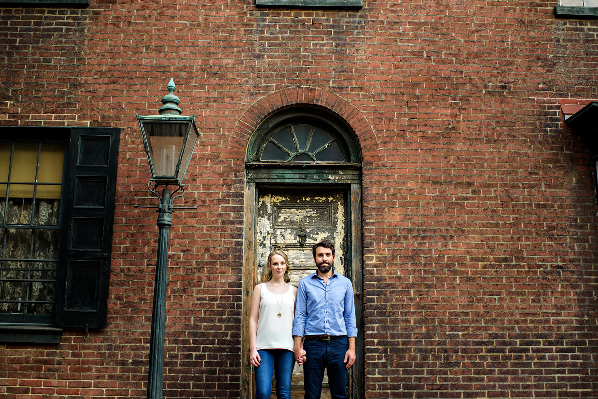 A couple in front of a south philly doorway.