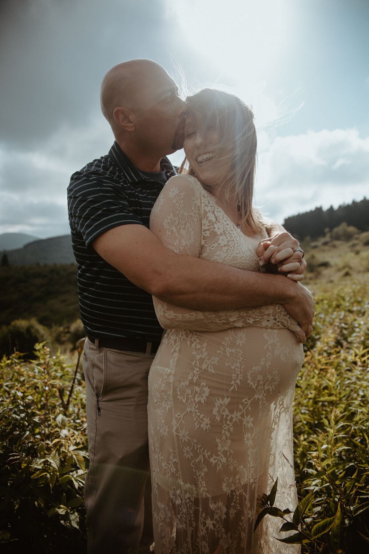 couple kissing in the blue ridge mountains