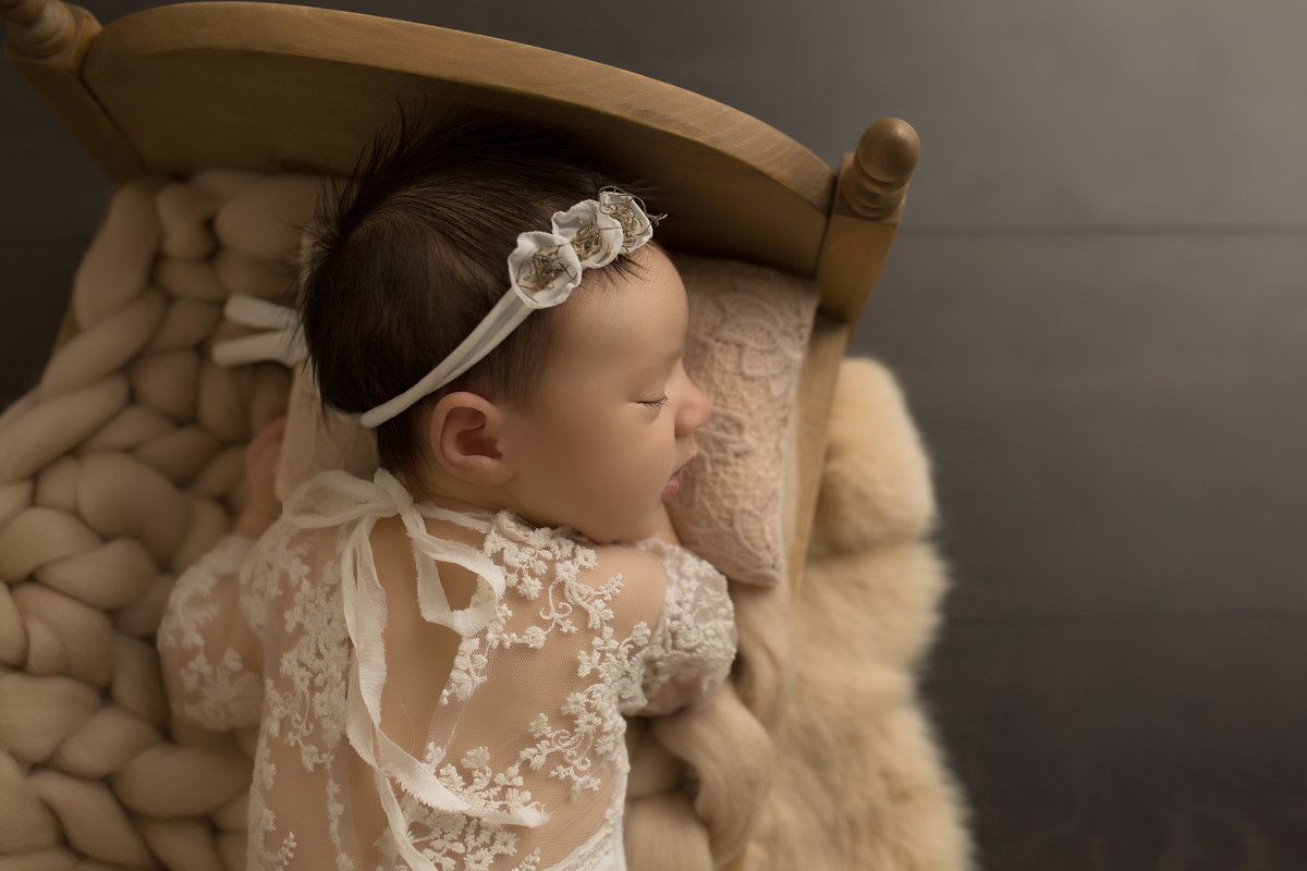 newborn baby girl in vintage crib