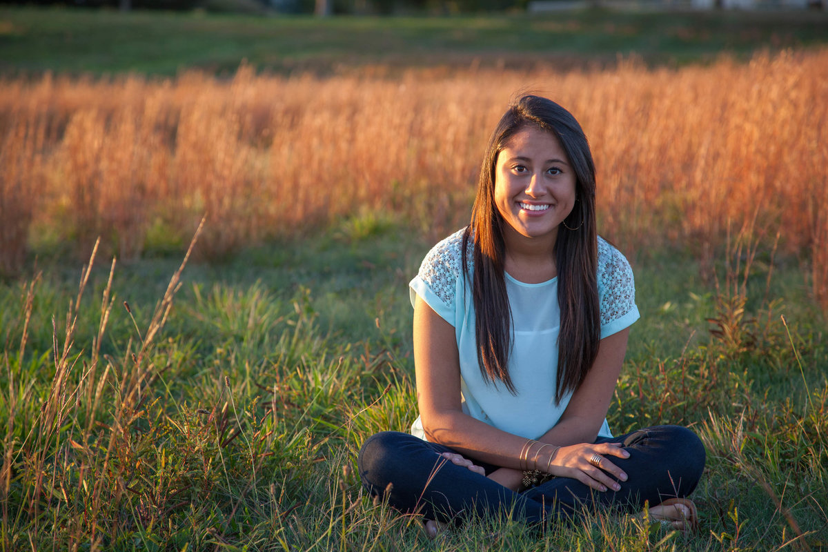 senior portrait in grass