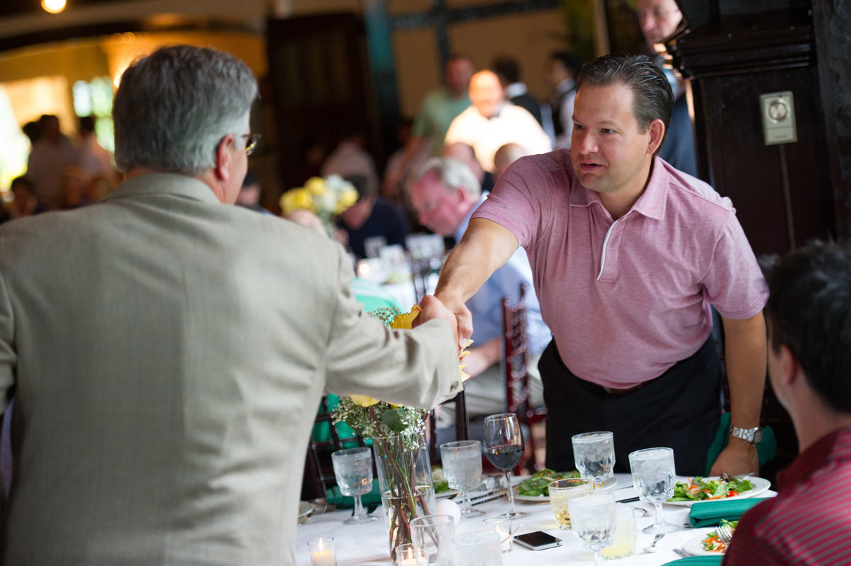 Two men shake hands at Chicago fundraising event.