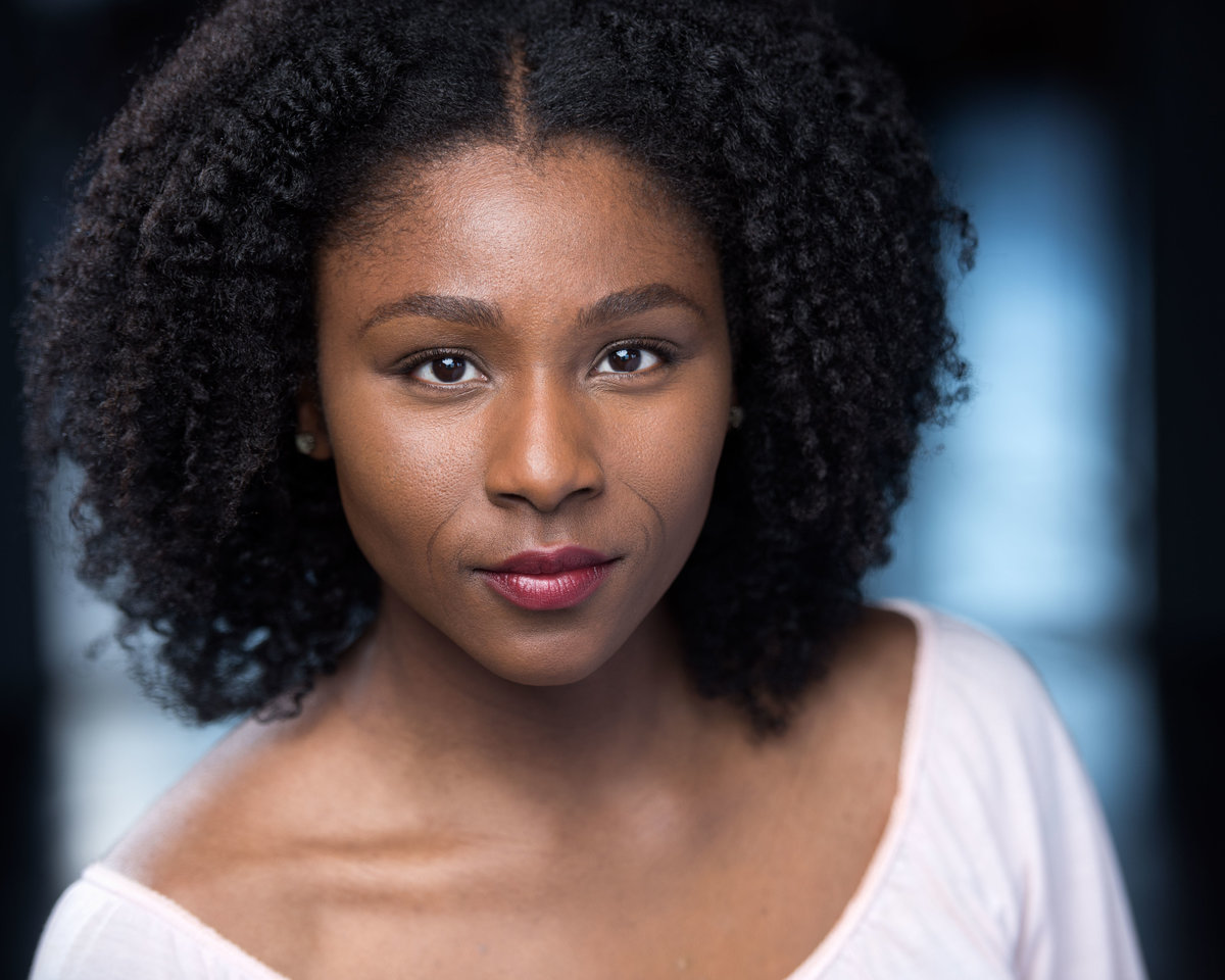 Chicago headshot for female actor, white top.