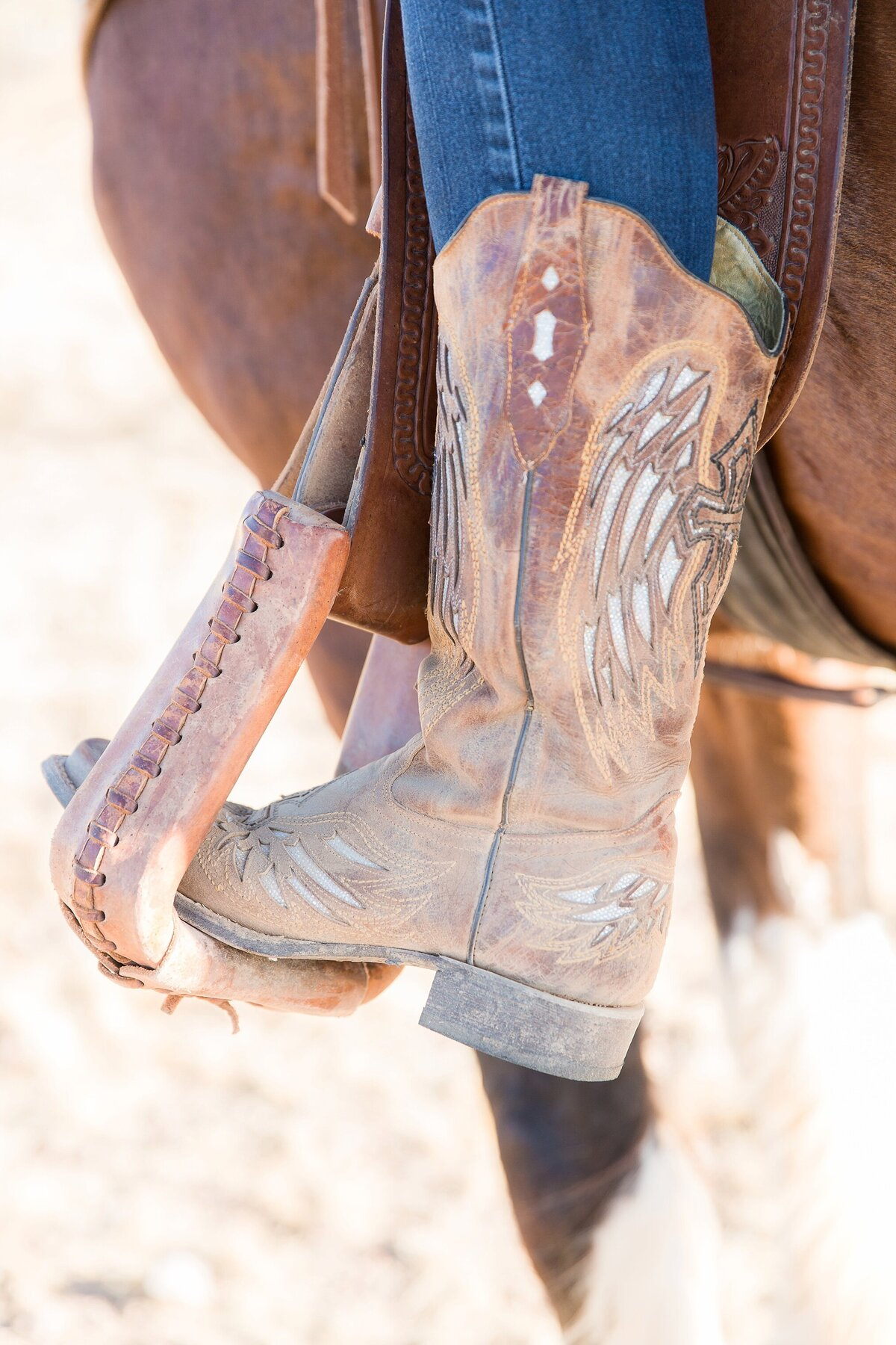 close up of a cowboy boot in a western stirrup