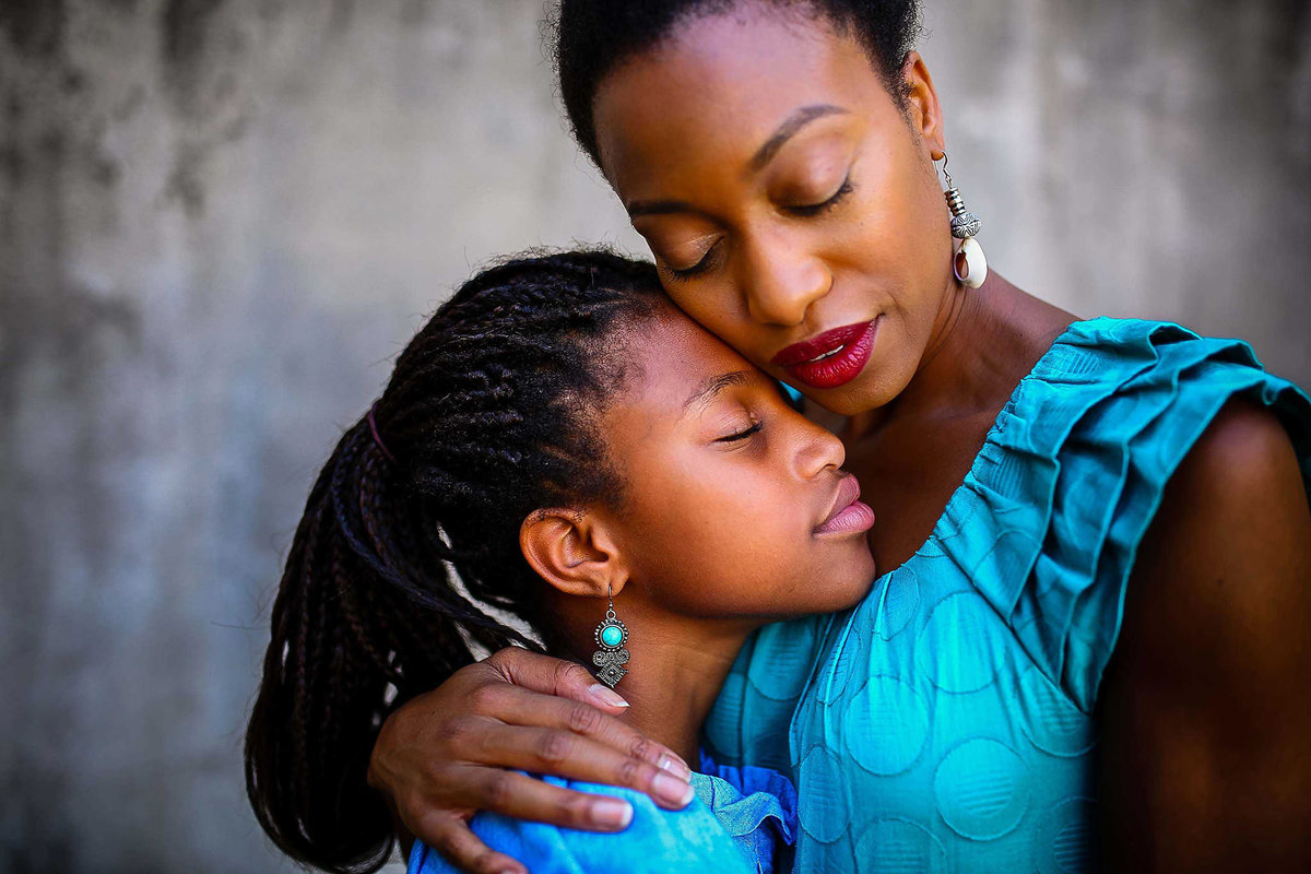 Mom embracing her daughter in their family photos by King and Fields Studios Charleston SC