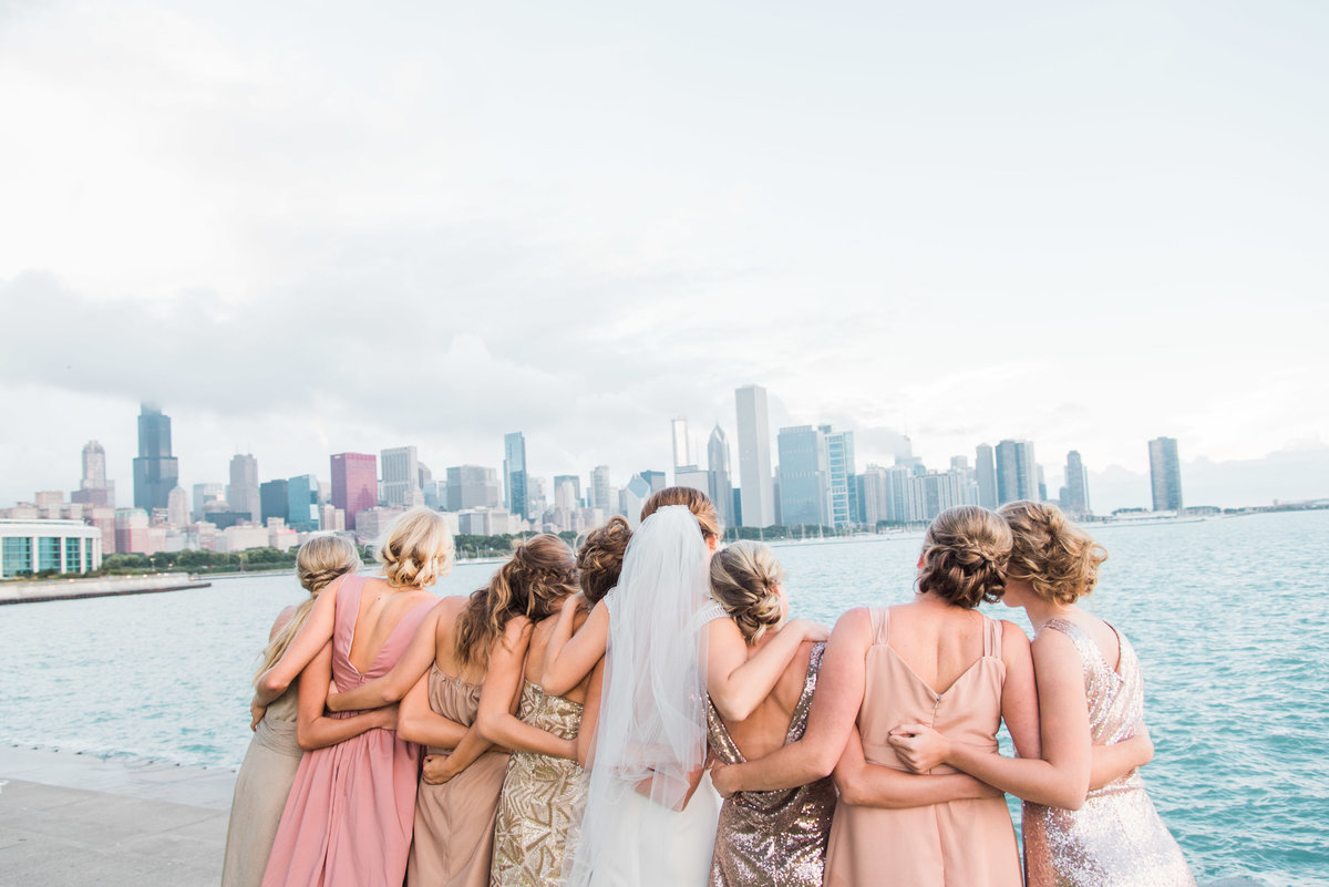 bride and bridesmaids overlooking downtown chicago