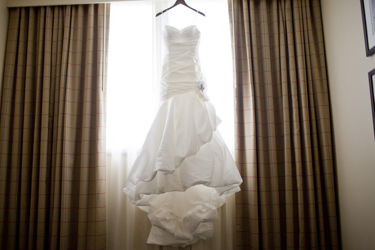 bride's dress hanging in window