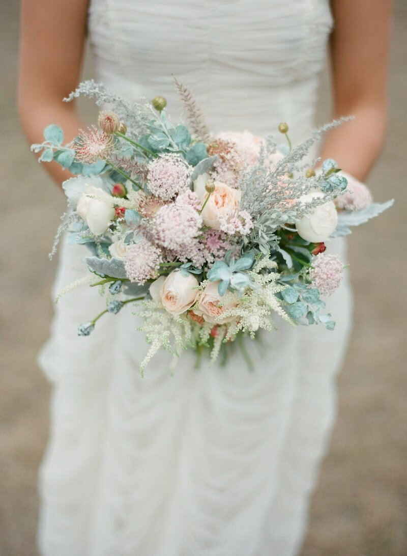 close up of bride peach and pink bouquet
