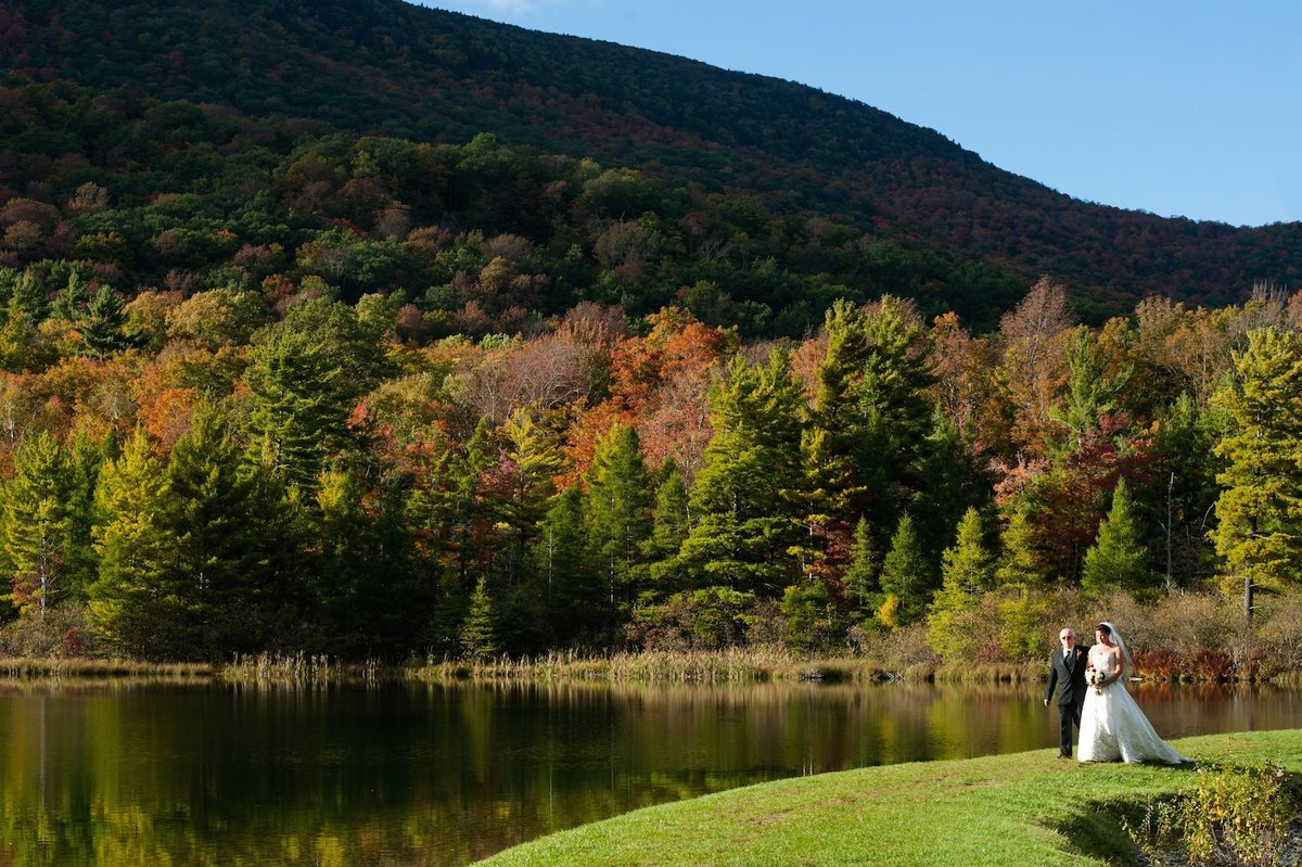 Fall wedding with foliage at the Equinox Inn - an outdoor wedding by the pond