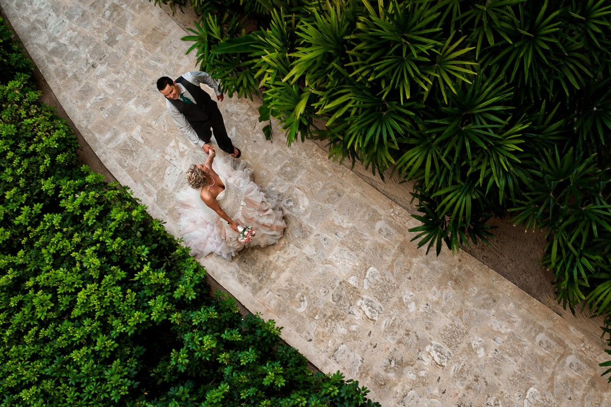 Charmaine and Chance enjoy some free time on their wedding day walking through the beautiful gardens around the Now Larimar resort in Punta Cana, Dominican Republic