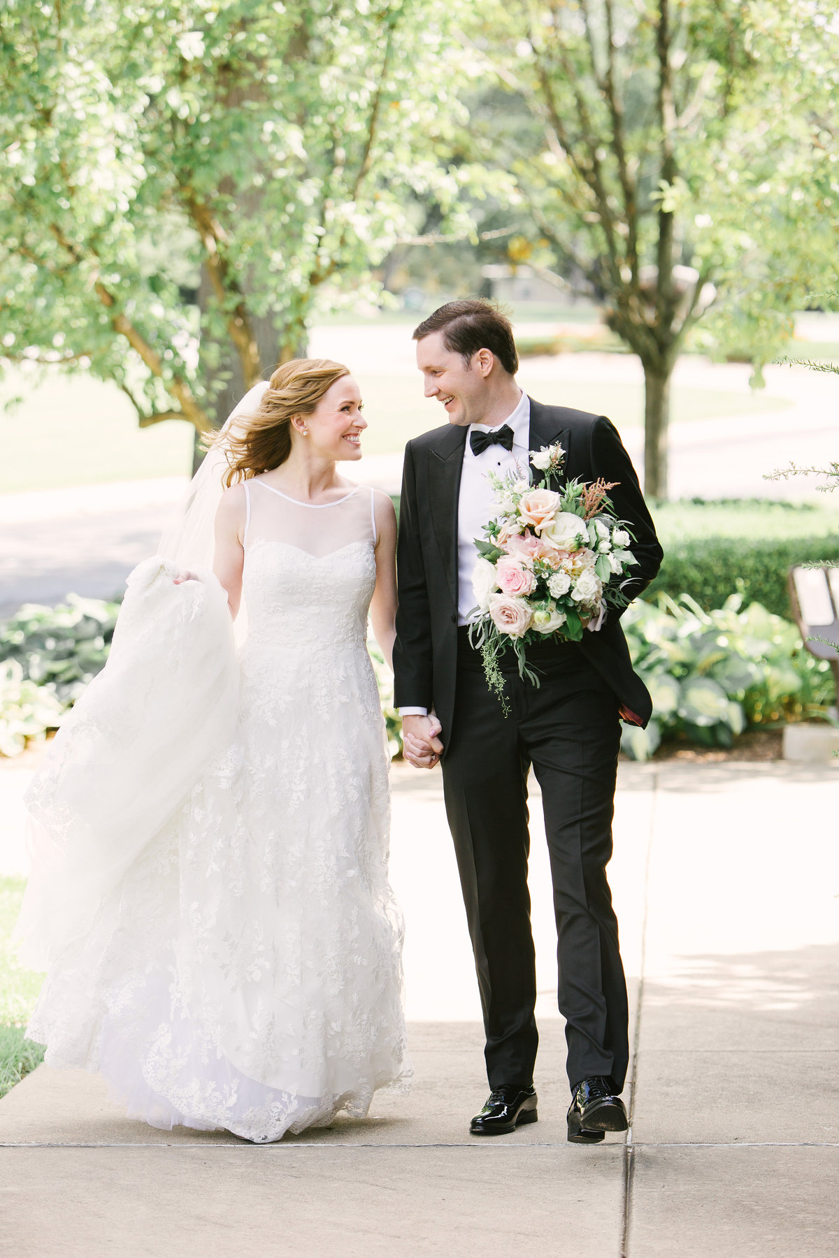 Scottish Rite Cathedral Wedding  Bride and Groom Walking Photo