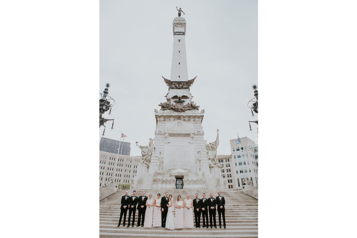 Wedding party stands at Monument circle in Indianapolis Indiana