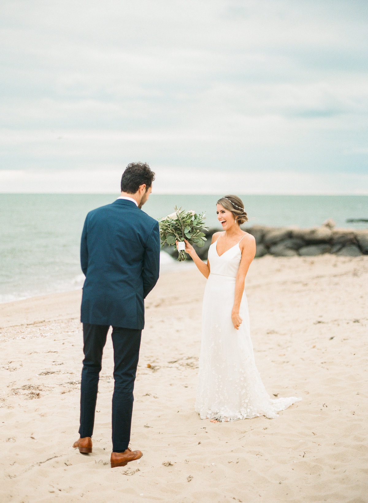 cape cod beach wedding first look couple on beach